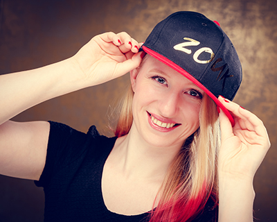 Lisa Denise van der Plaats wearing a Zouk baseball cap